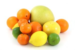 9266-a-pile-of-citrus-fruit-isolated-on-a-white-background-pv